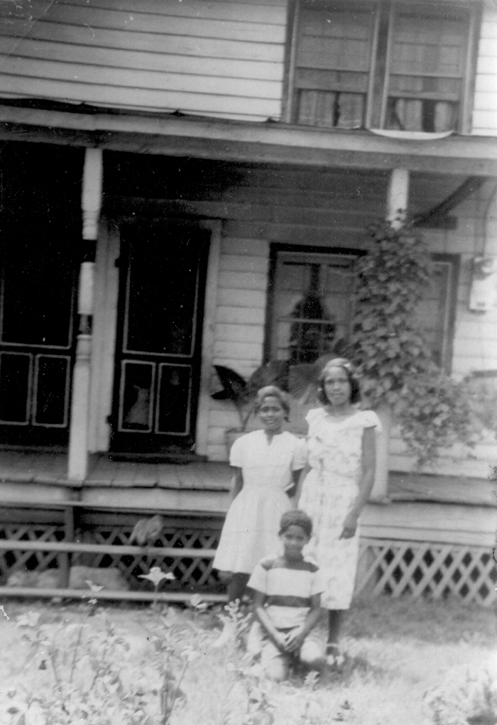 The Johns children, Barbara Rose, (16), Joan Marie, (13) and Ernest Everett (10), at their grandmother's house on a Sunday after church in 1951.